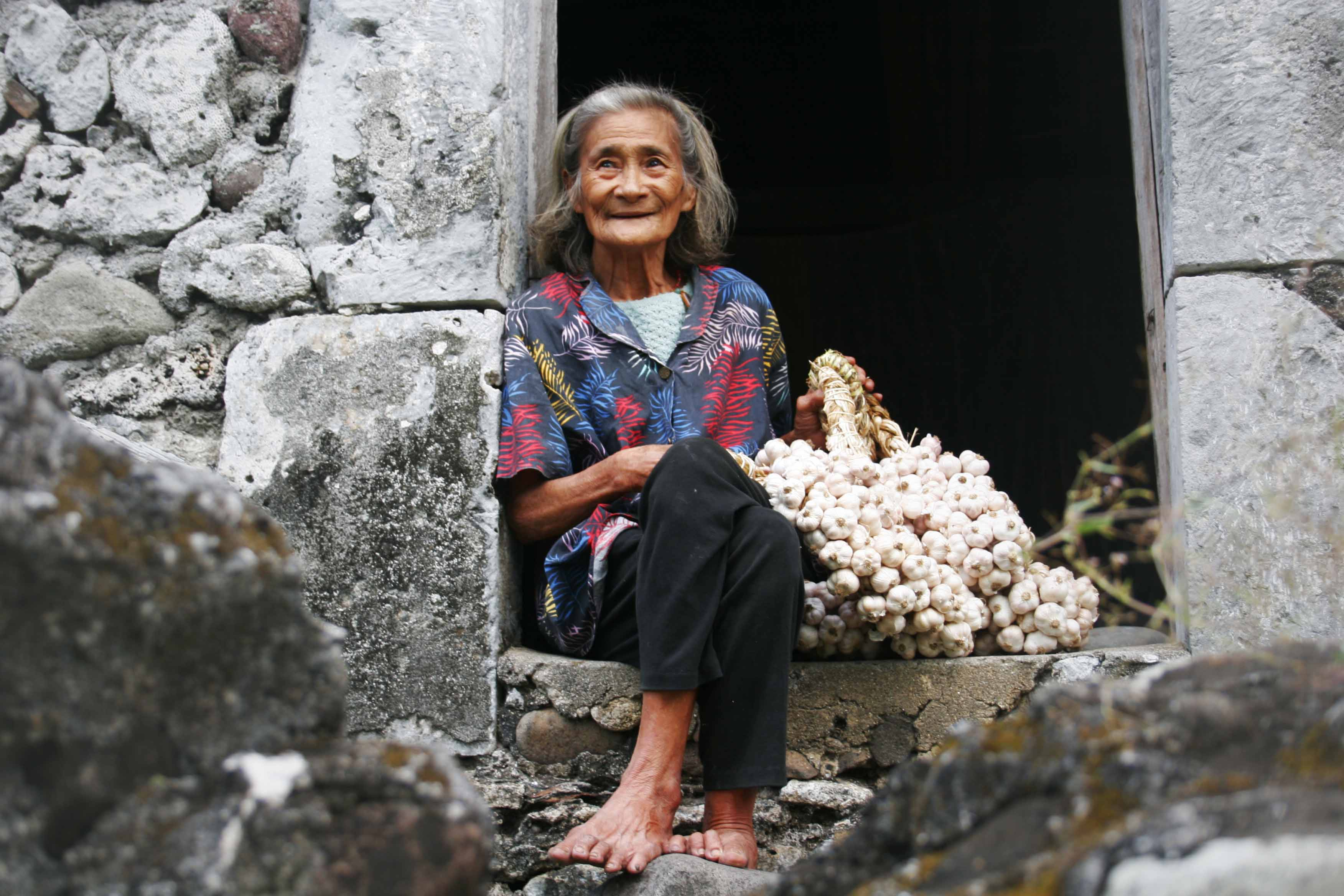 "Batanes lola in front of her traditional Ivatan home at Barangay Salagao, Ivana, Batanes (Published at Reader's Digest Asian Edition at the Unseen Asia feature, November 2006 issue; FPPF exhibit ""Amazing Batanes"" at SSS Gallery)"